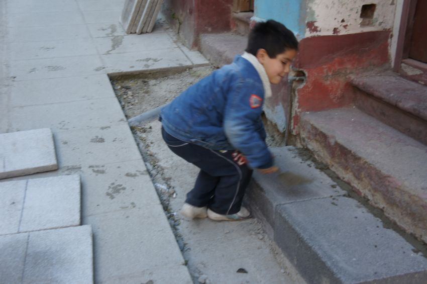 Child playing in street