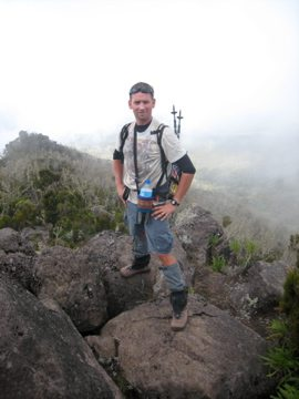 man above clouds on mount kilimanjaro