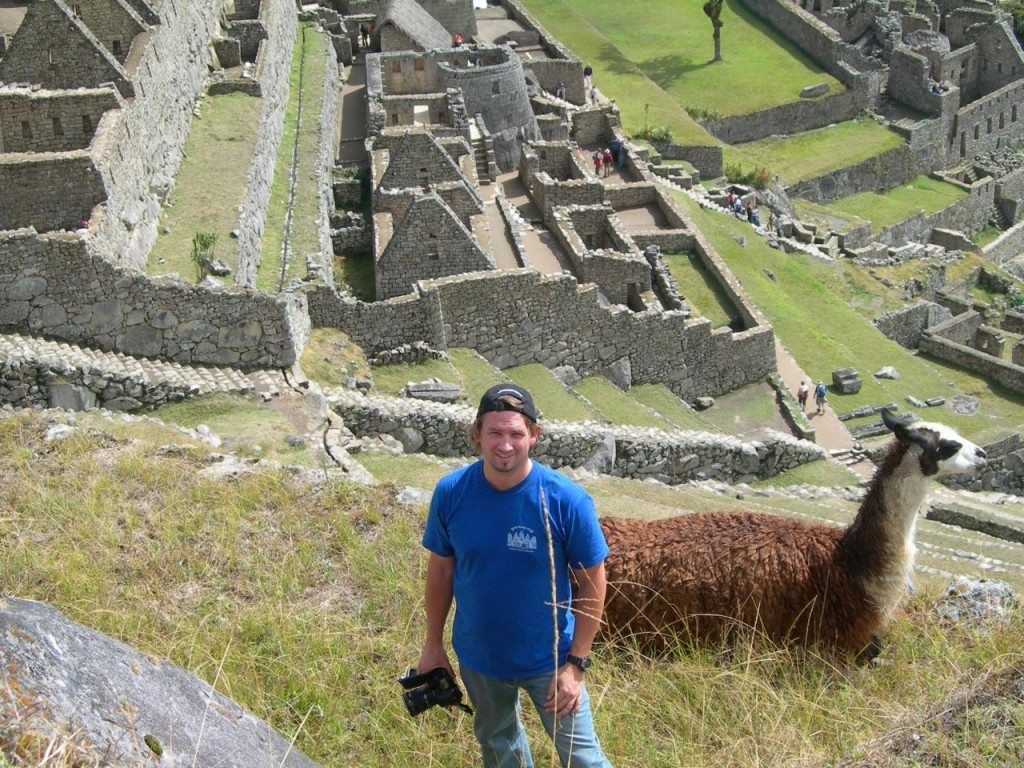 man at machu picchu with llama
