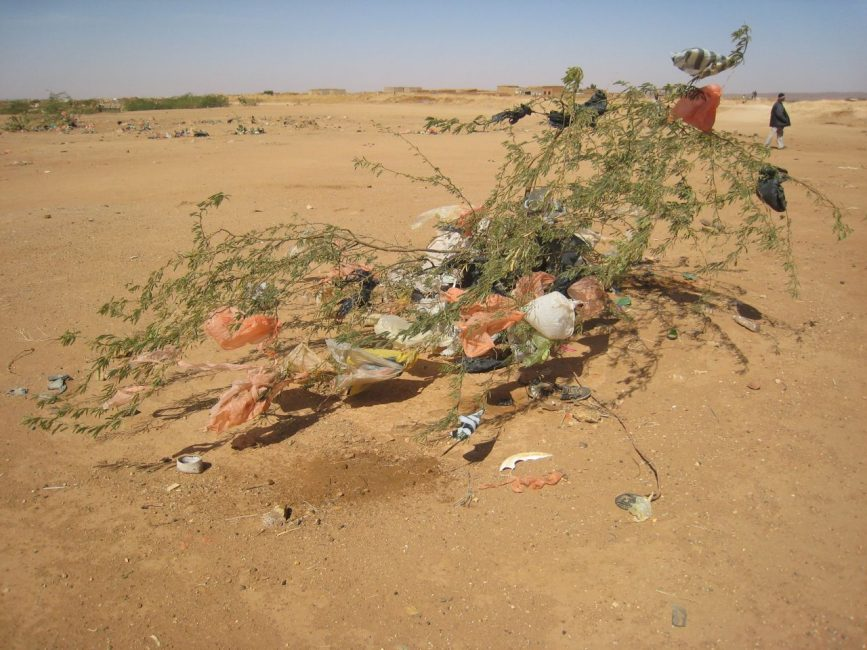 plastic and garbage in african desert