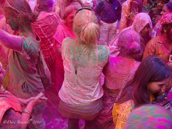 dancing and celebrating in holi, india