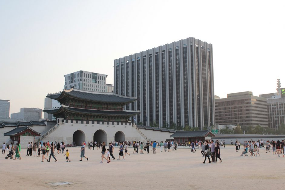 vast complex of Gyeongbokgung with modern seoul in background