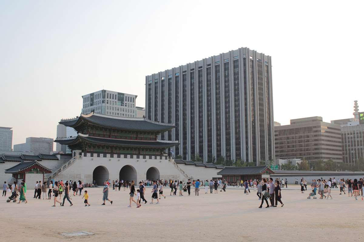 vast complex of Gyeongbokgung with modern seoul in background