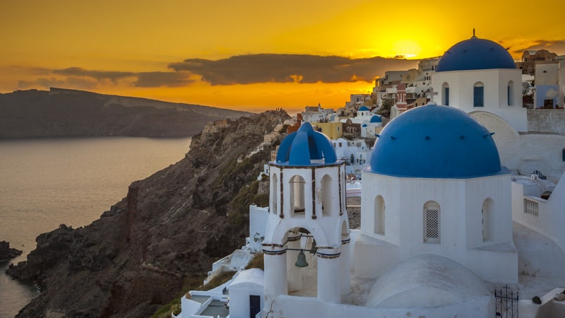 Santorini Greece sunset over blue domes