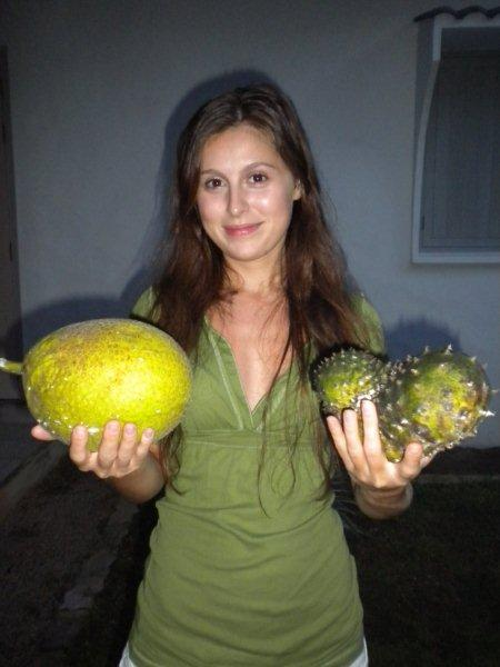 woman holding breadfruit and sour sap