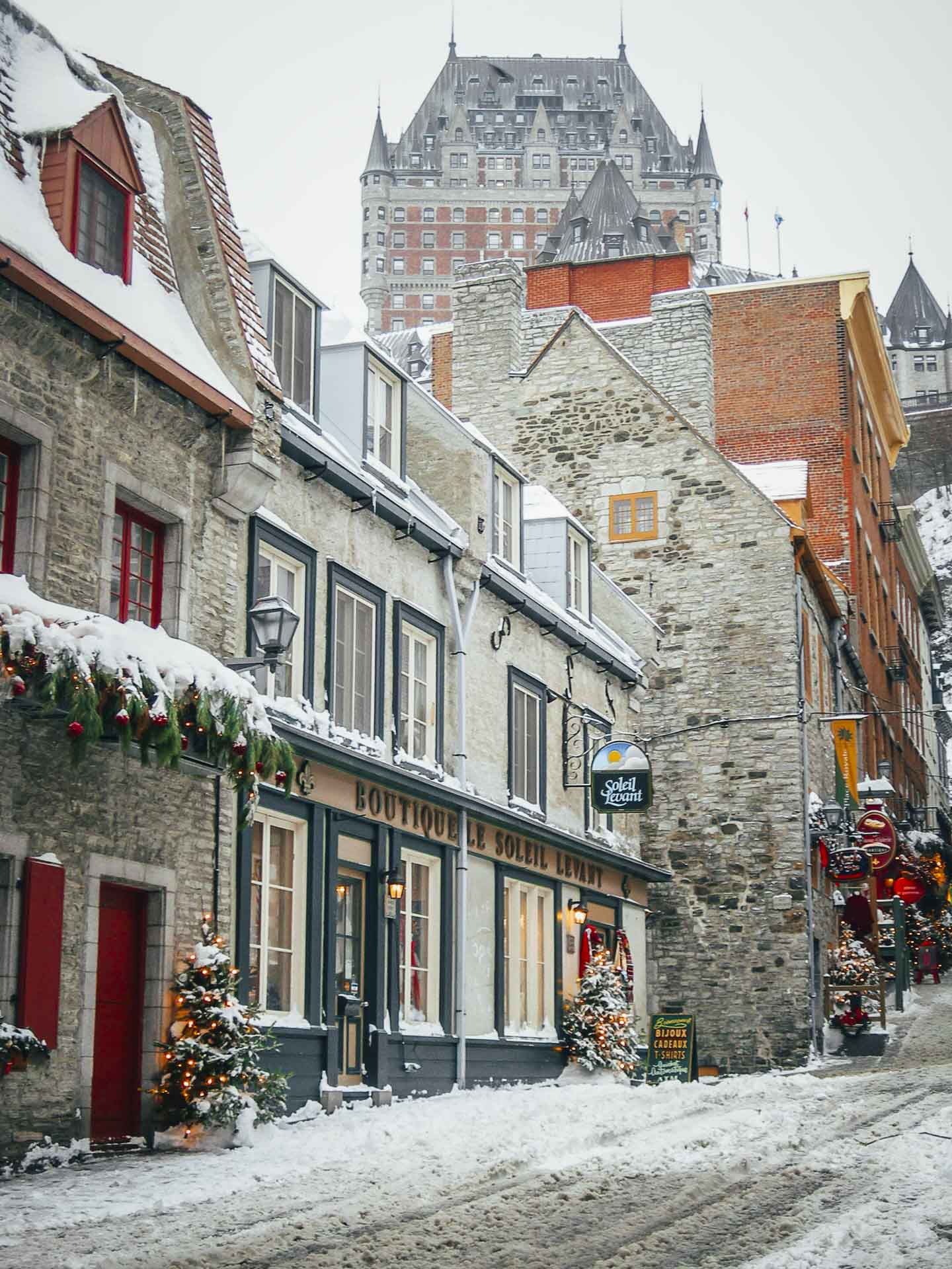 old quebec city in winter with chateau frontenac in background