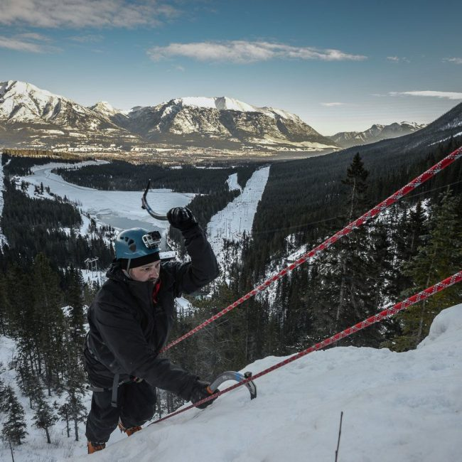 Canadian Rockies in background while ice climbing