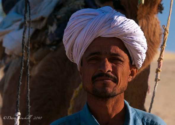 Camel Guide's weathered face in India Desert