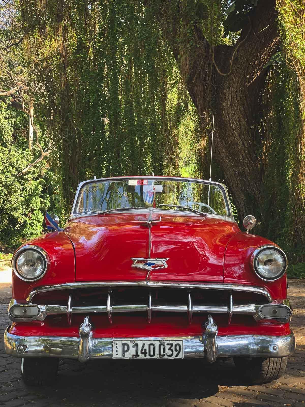 fun facts about cuba - classic red convertible in Havana Cuba