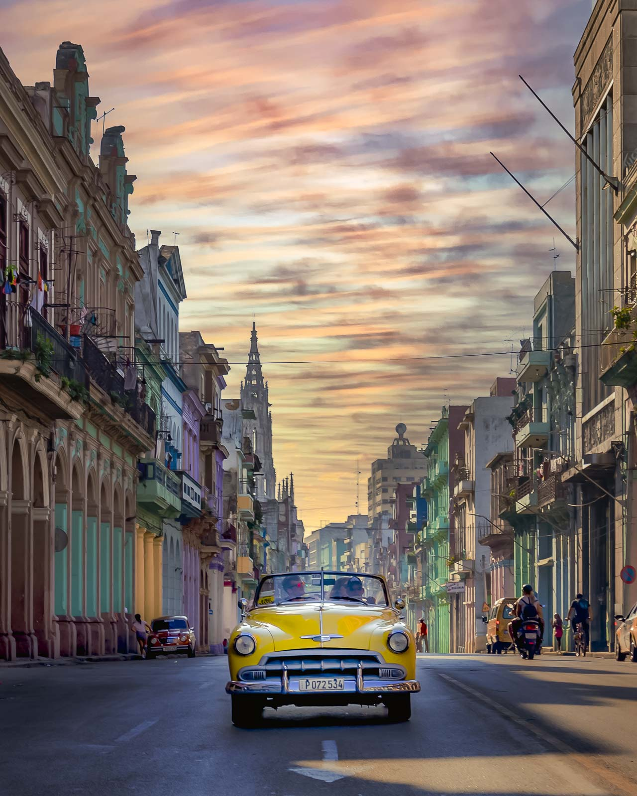 interesting facts about cuba - car driving through world heritage site of Havana