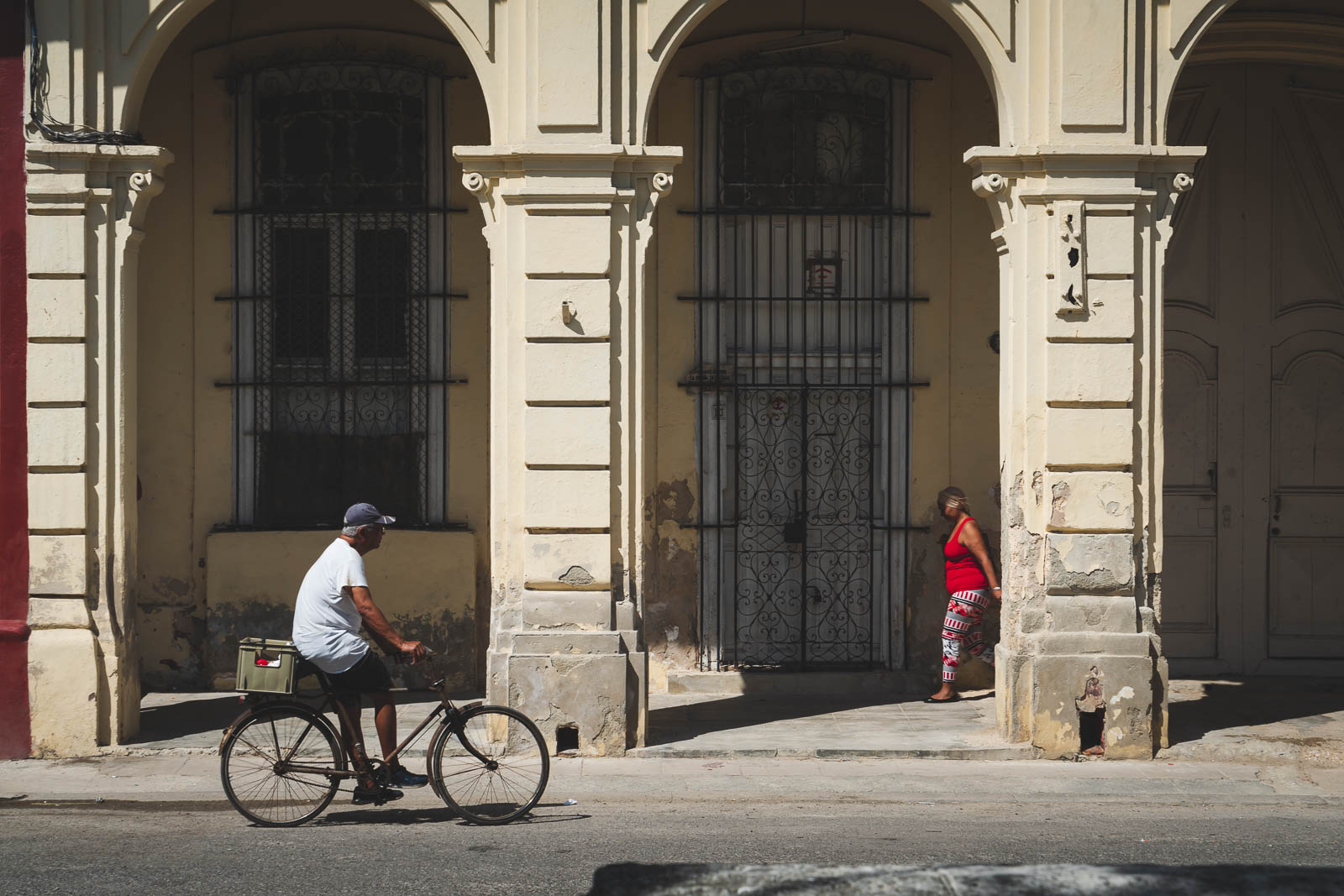 cuba facts - it's divers - a man riding his bicycle