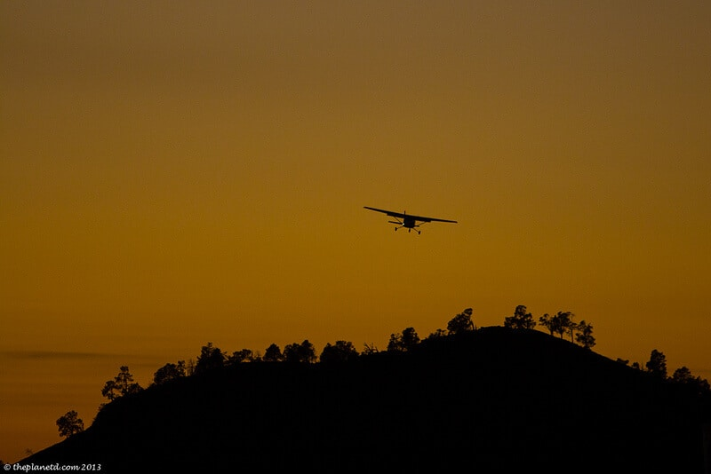 Flinders Ranges Australia - airplane taking off over Wilpena Pound
