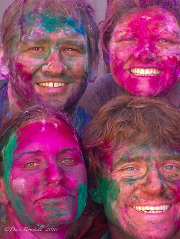 four faces at holi festival