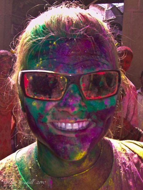 deb face covered in multiple colours at Holi Festival India