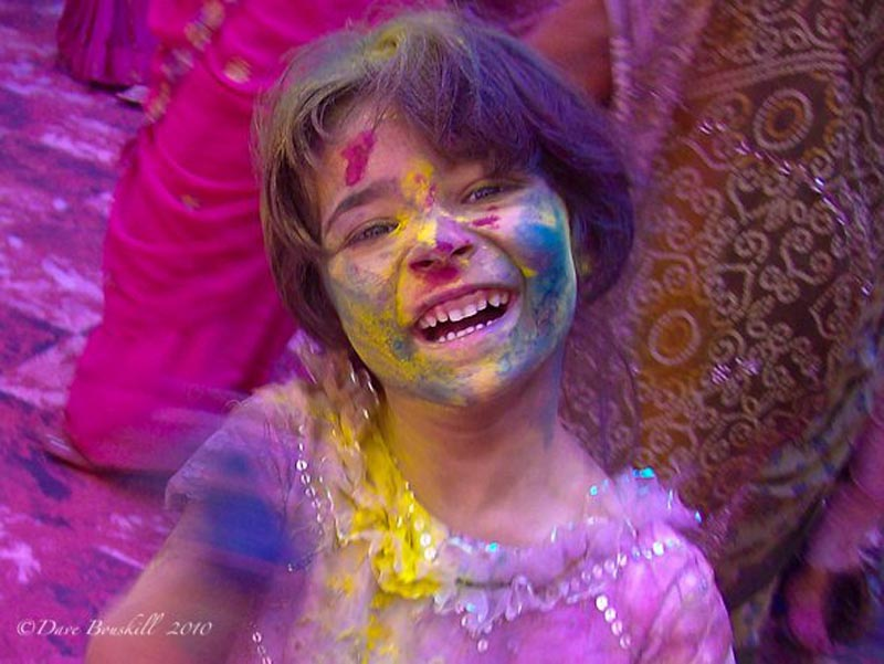 child smiling during holi india