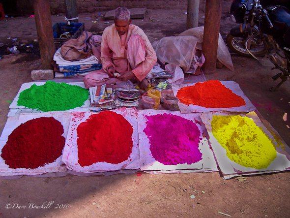 Vendor sells coloured powder for holi festival