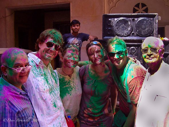 tourists covered in colours of Holi