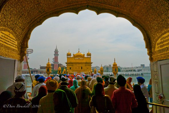 large crowd waits to enter golden temple