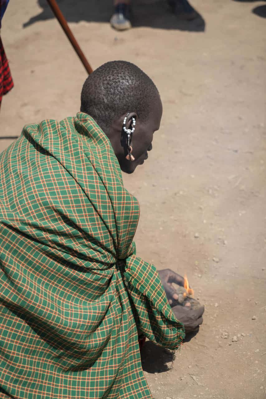 Maasai man making fire