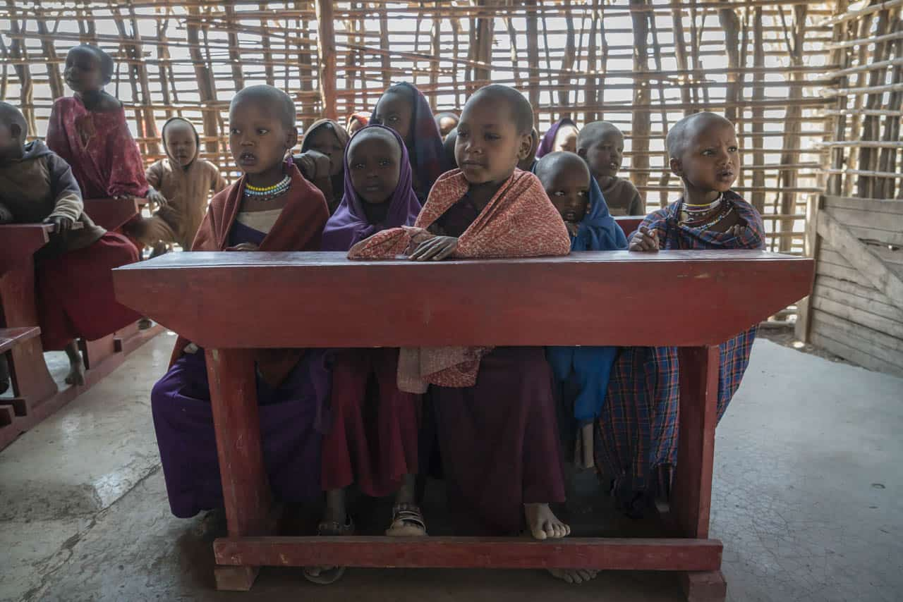 Maasai school visit children at desk