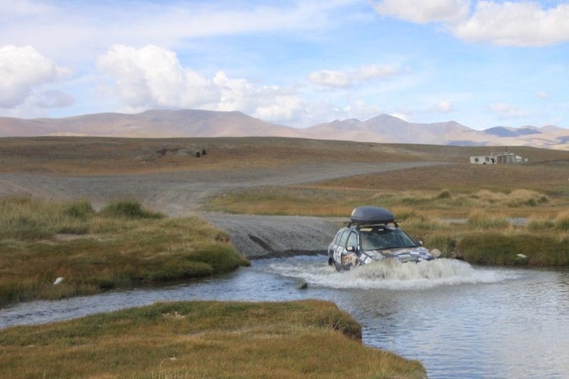 mongo rally car driving through river