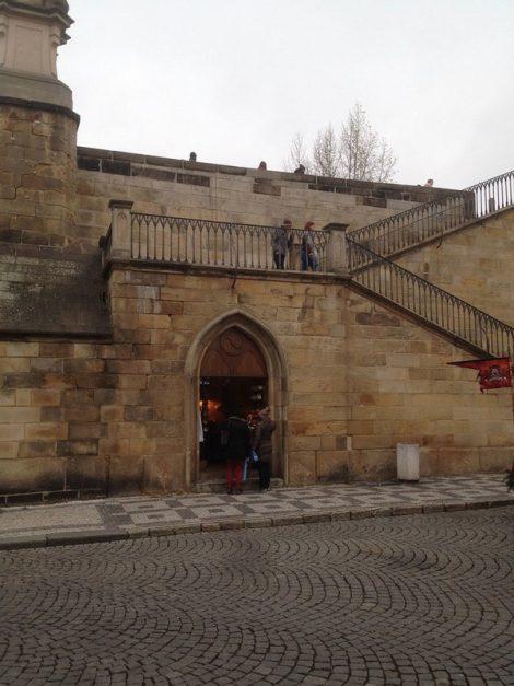 Prague tourist traps stairs under bridge
