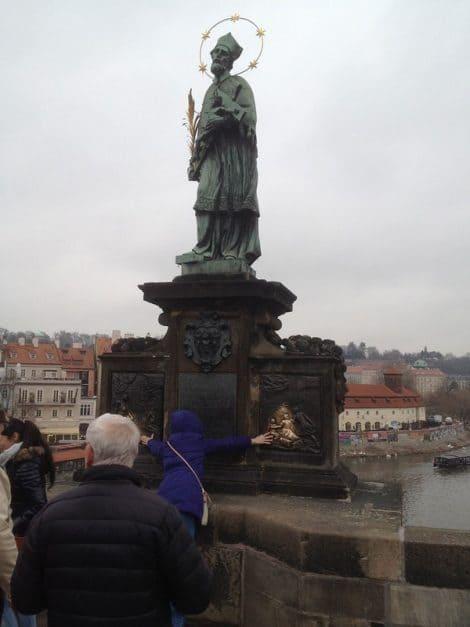 Prague sights to avoid - statue of St. John on Charles Bridge