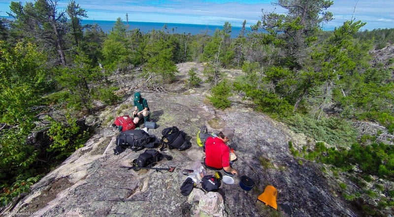 stopping for lunch while hiking in Pukaskwa National Park