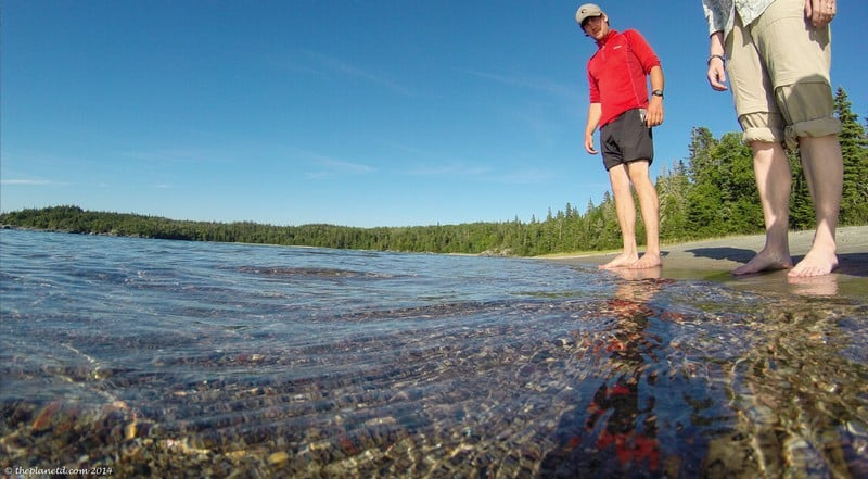 standing in Lake Superior in Pukaskwa National Park