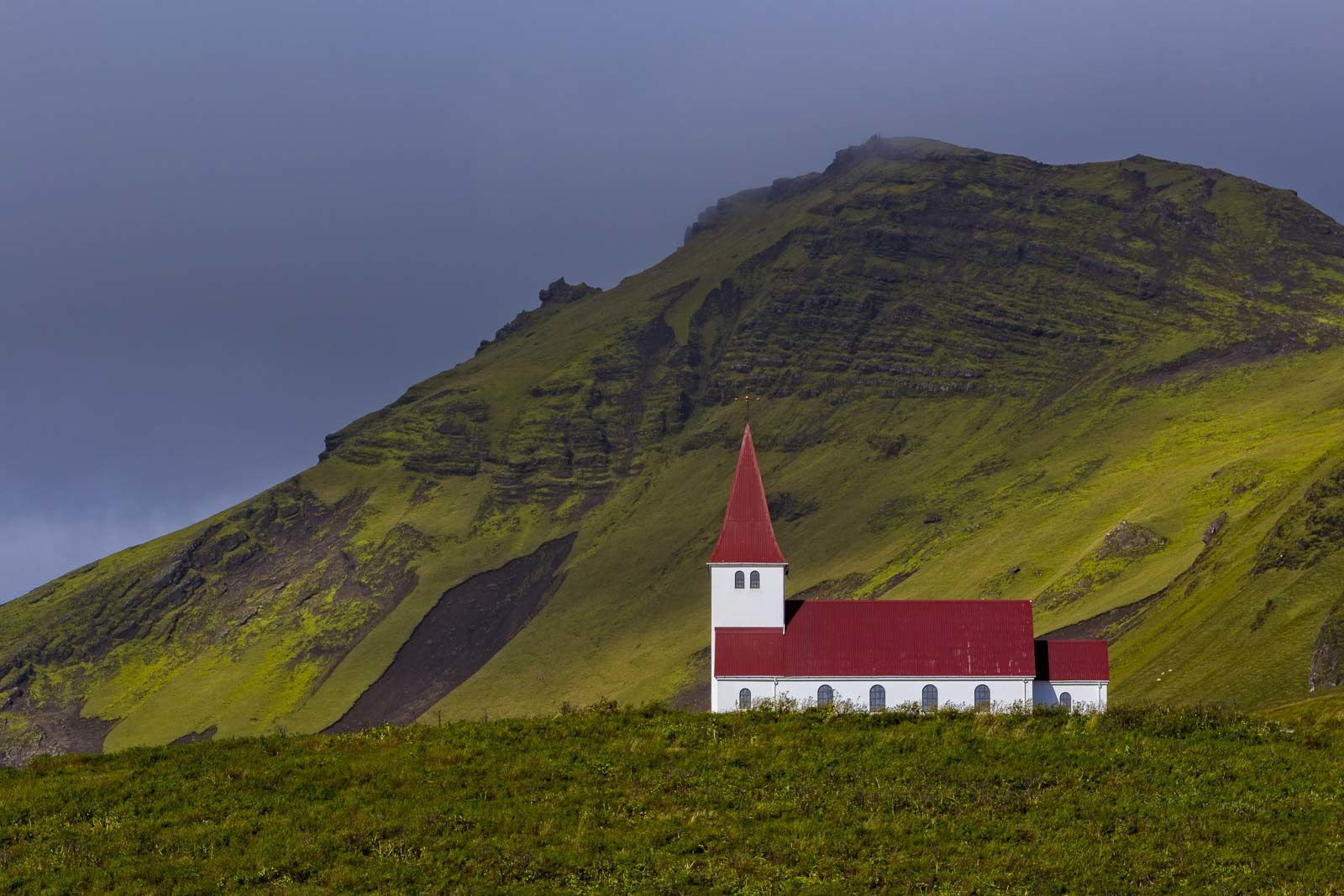 ring road iceland church with mountain.