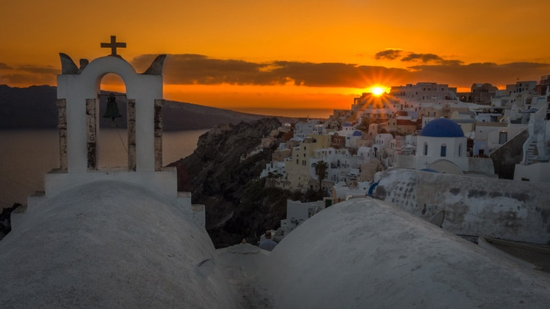 sunset over oia santorini photography guide