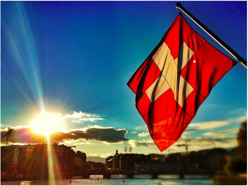 swiss flag shines in sunset