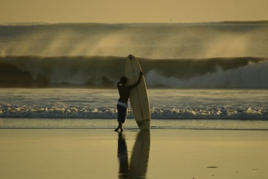 A Real Surfer Waiting for a Wave