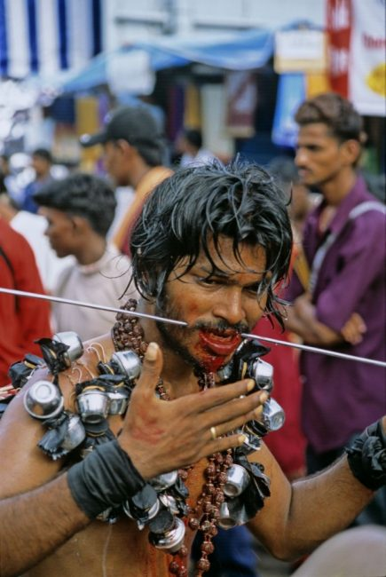 Thaipusam pilgram puts spike through cheek