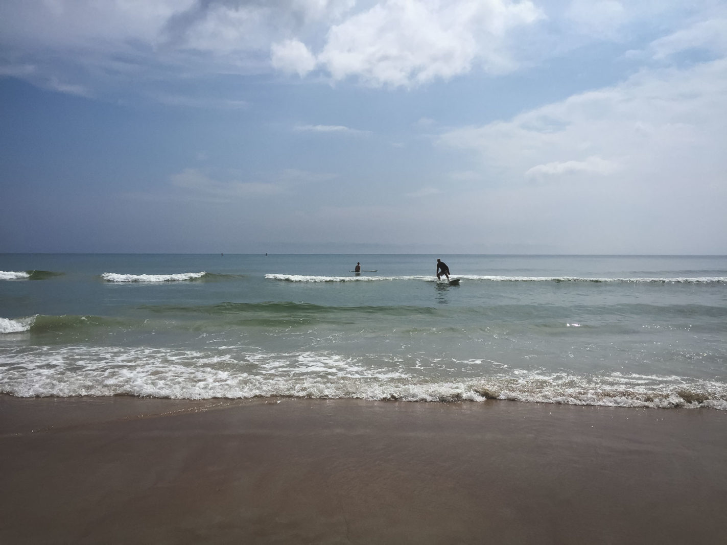 surfing the waves at Daytona Beach