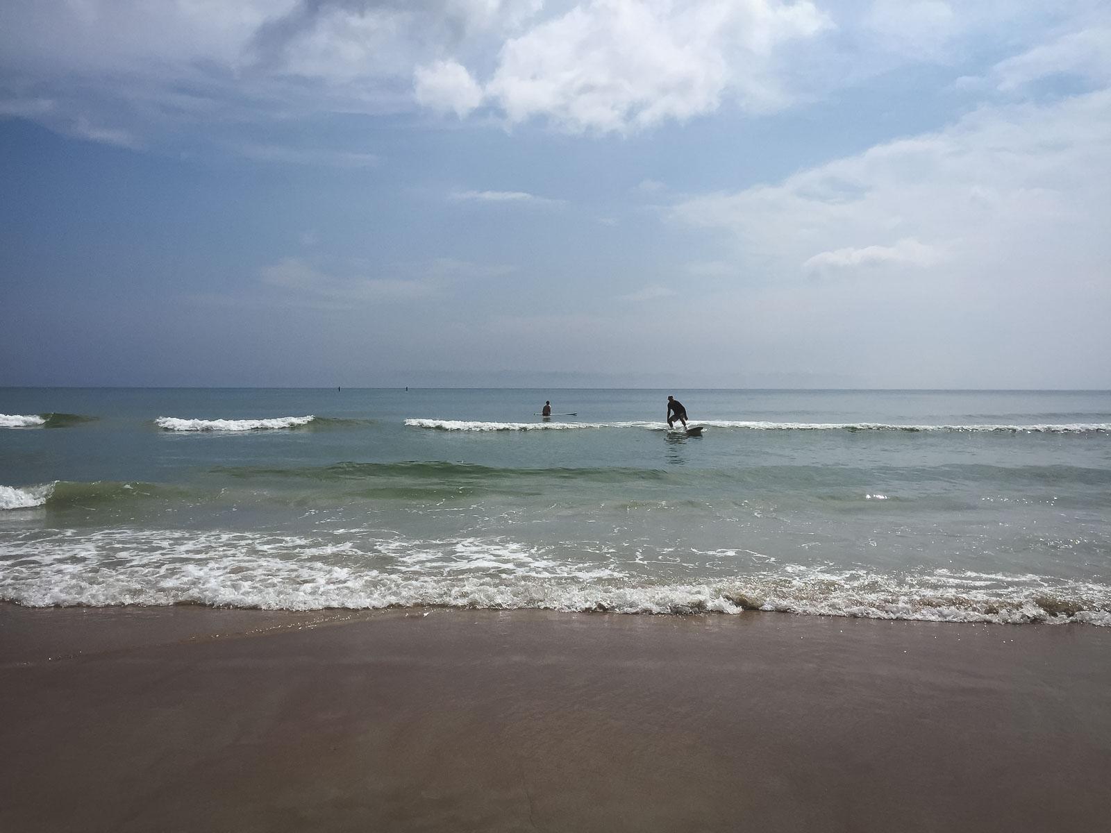 surfing the waves at Daytona Beach