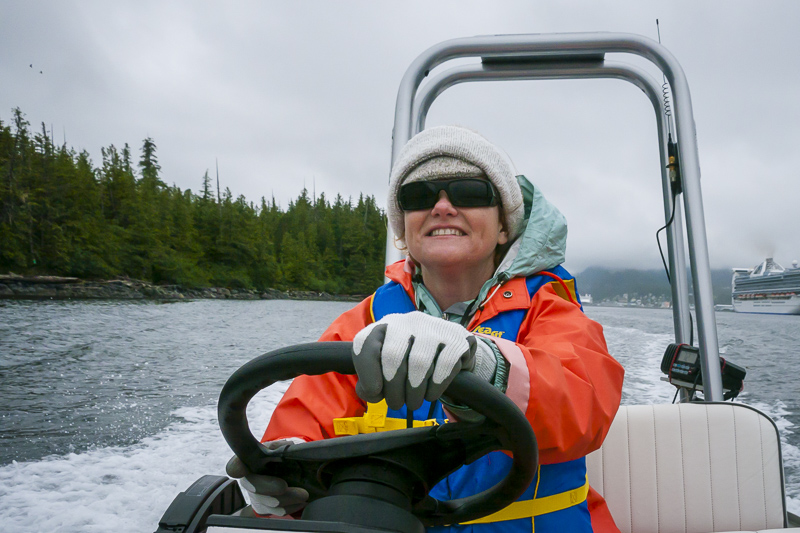 Deb driving a zodiac in Ketchikan, Alaska