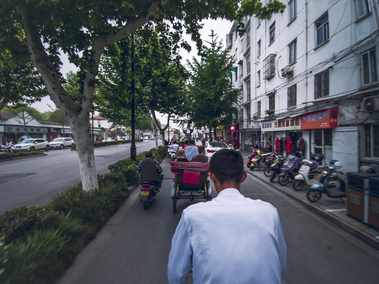 Rickshaw ride through the streets of Suzhou