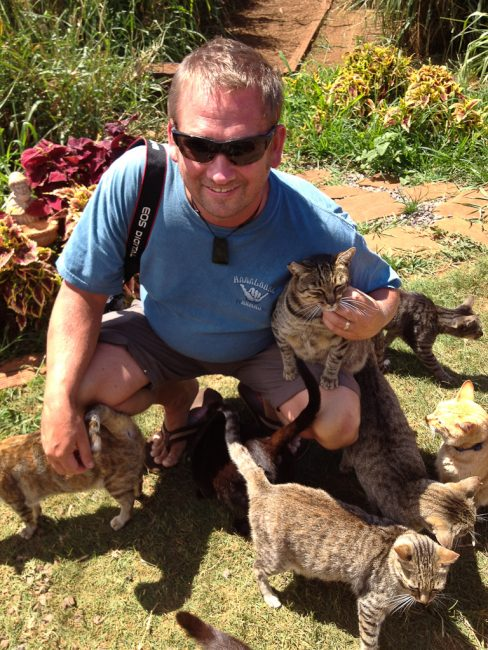 adventure travel photographer Dave with cats