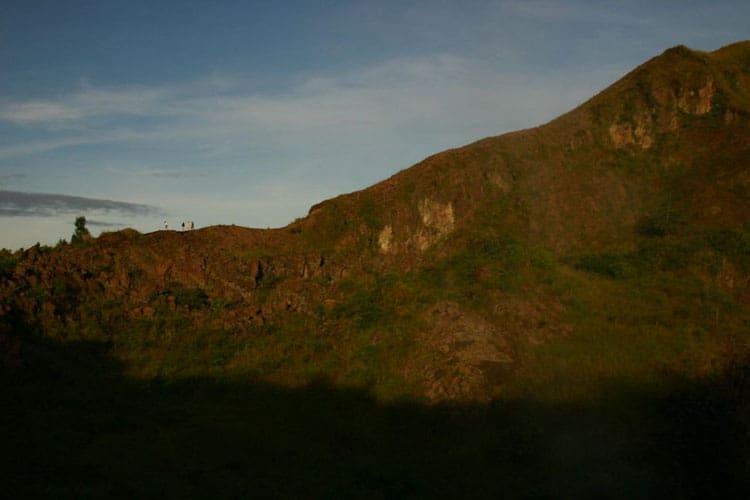 hiking on the craters edge of gunung batur bali