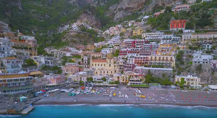 positano italy | beach and city by drone