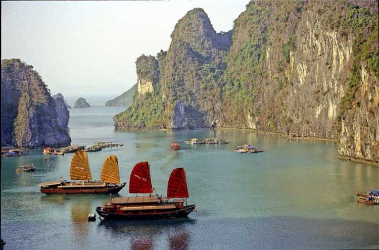 places to visit in the world | ha long bay with junk boats