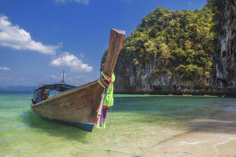 long tail boat on beach in thailand