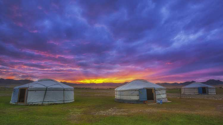 yurts in mongolia at sunset
