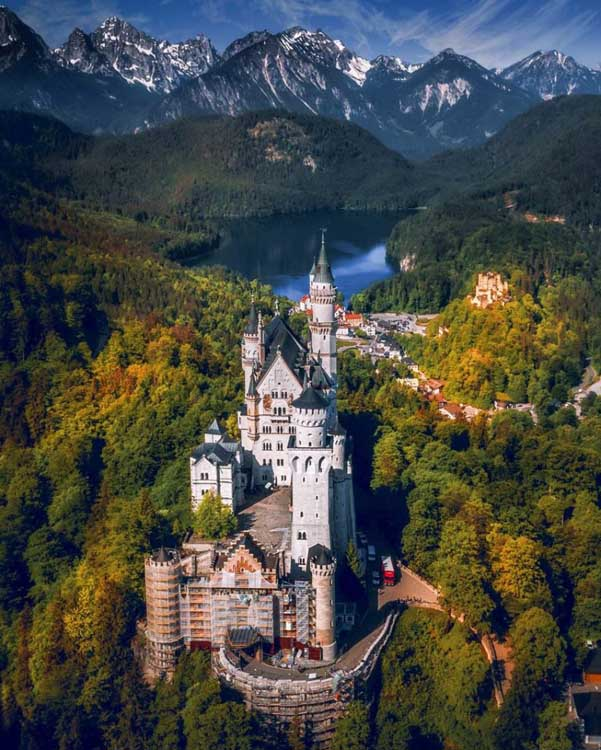 arial view of neuchwansteain castle in bavaria