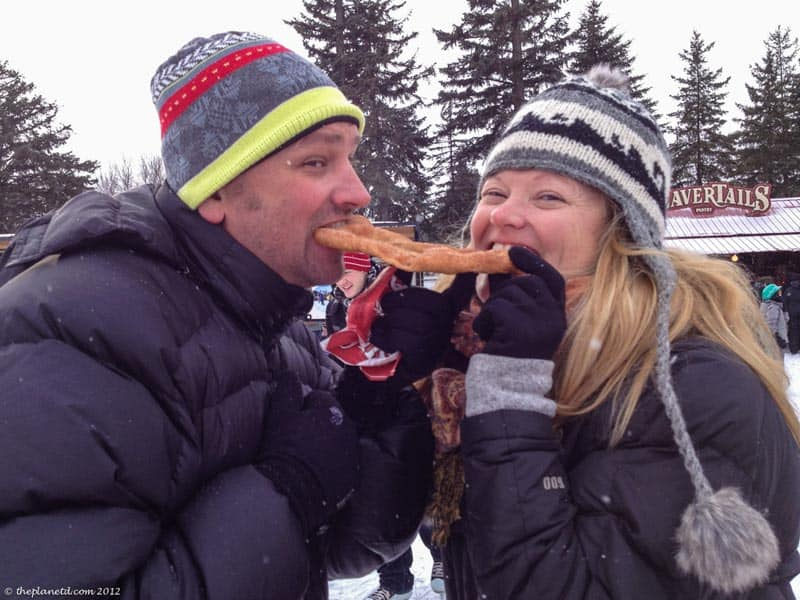 enjoying a beavertail at winterlude