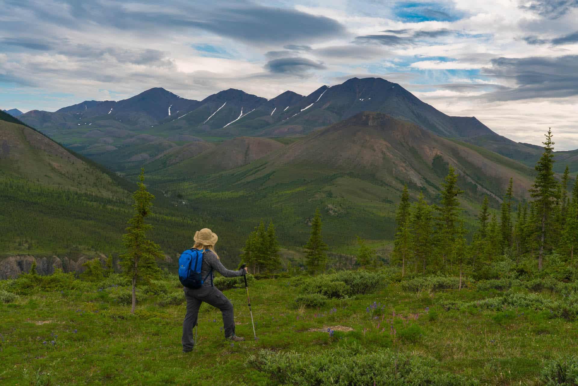 best adventure travel blogs | woman hiking in yukon
