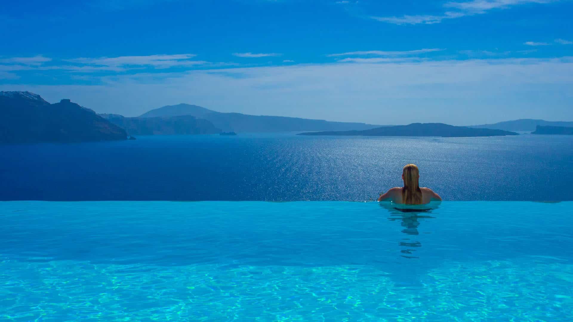 luxury travel blogs | infinity pool in santorini greece