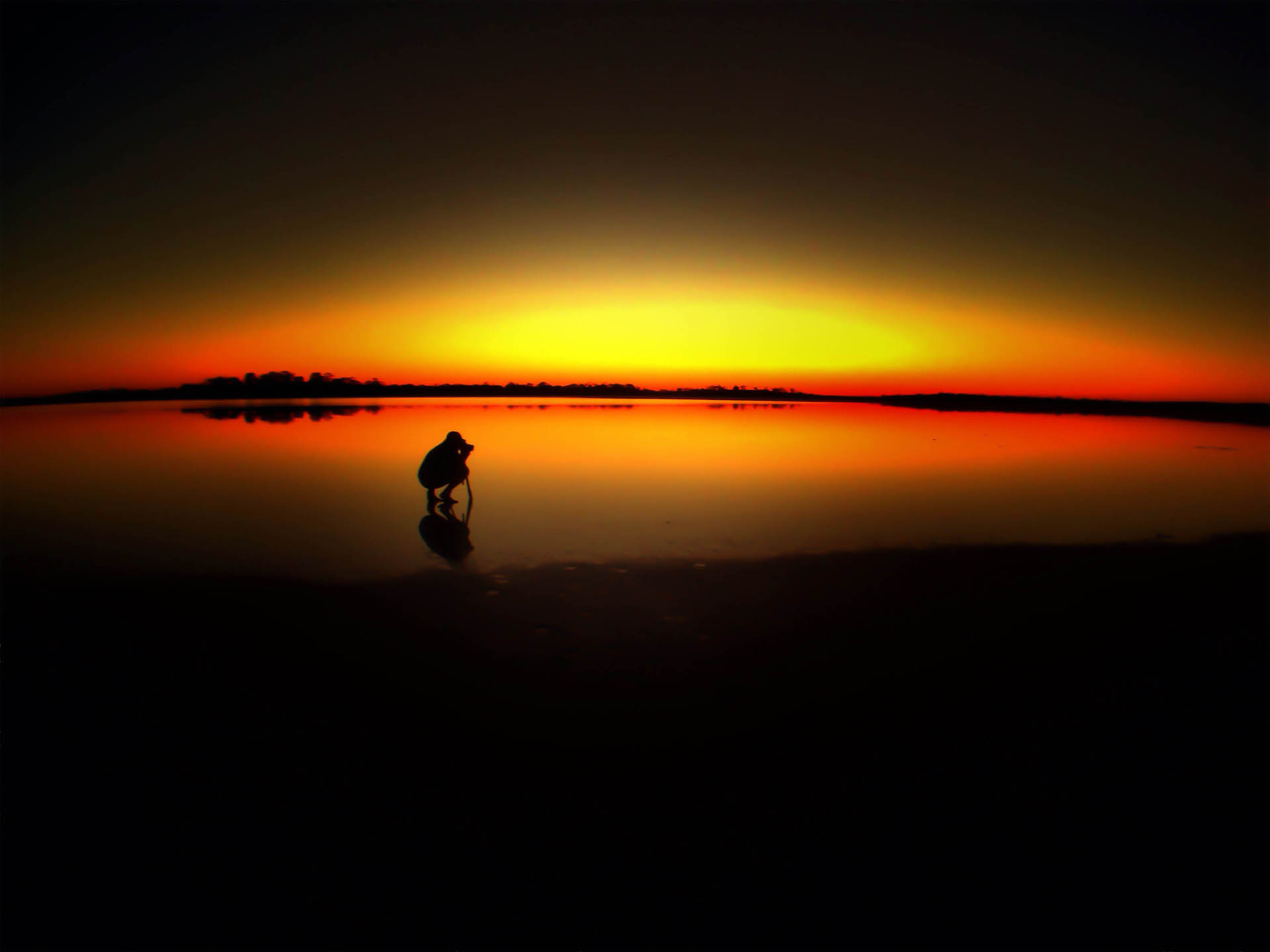 travel photographers photography blogs | silhouette on lake reflection at sunset