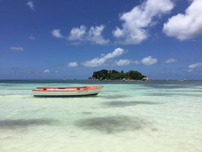 seychelles tropical islands | boat and island